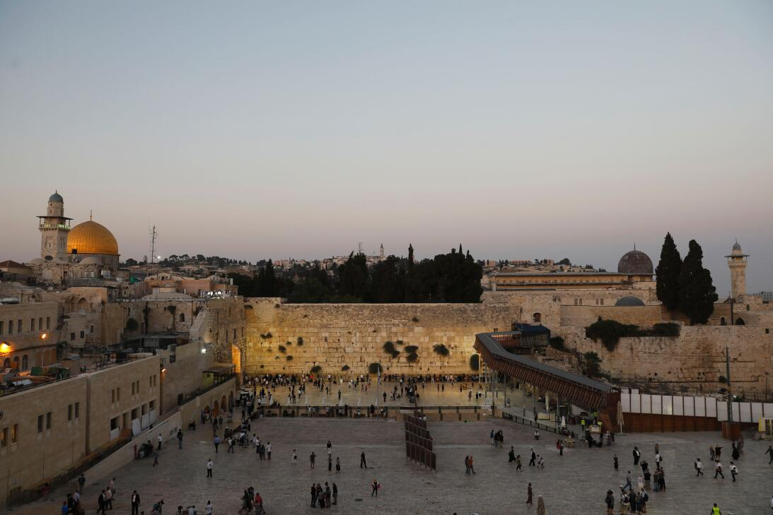 A general view shows Orthodox Jewish men and women gathering at the West...