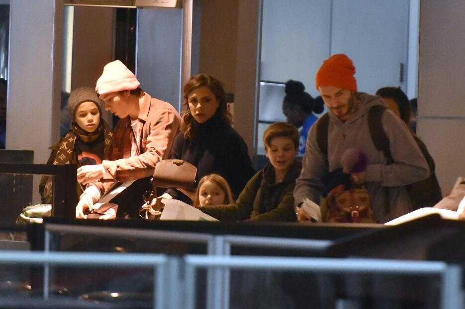 David and Victoria Beckham arrive at JFK Airport with their children Har...