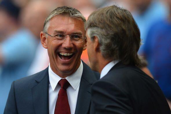 Caras de felicidad con los entrenadores de Manchester City y Southampton...