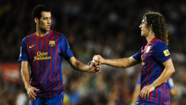 Puyol le heredó su número '5' a su amigo y ex compañero Sergio Busquets.