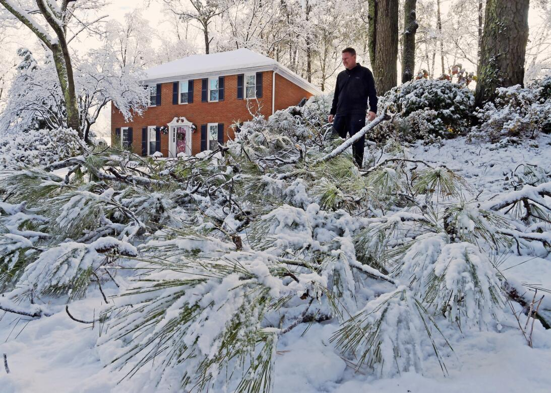 Laura Washington shovels her walk after a heavy snow, Saturday, Dec. 9,...