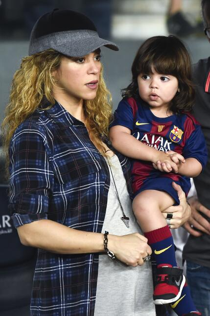 Shakira and her son Milan look on during the La Liga match between FC Ba...