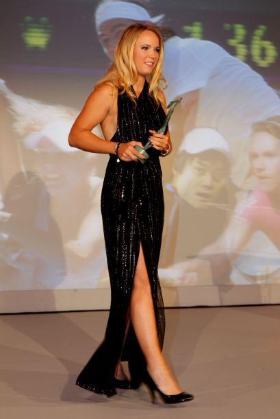 La tenista octava del mundo, la danesa Caroline Wozniacki, festeja este...