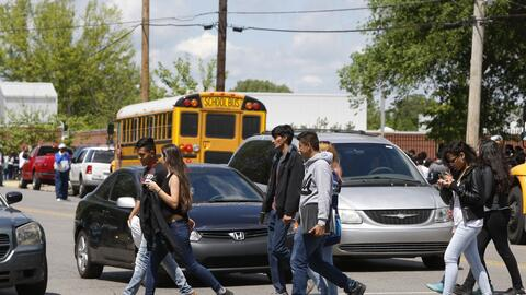 In this April 21, 2016, photo, students are shown in a Hispanic neighbor...