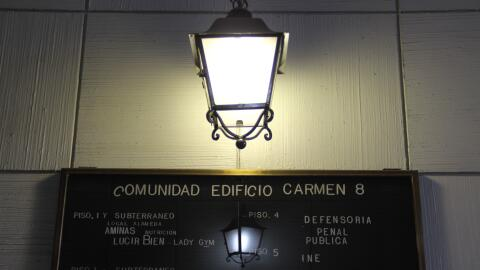 Until a few weeks ago, a sign at the Carmen 8 building in Santiago with...
