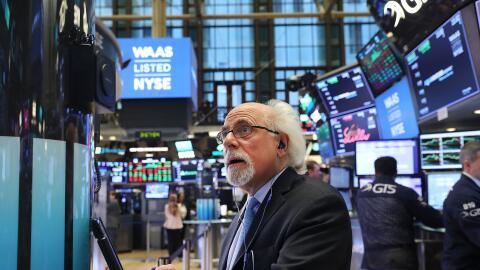 Operadores de Bolsa de Nueva York. El índice promedio industrial...