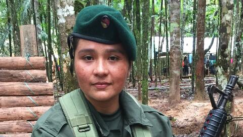 Elisabel, a 26-year-old FARC fighter at rebel camp in southern Colombia....