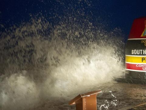 Waves smash into the marker at Key West's Southernmost Point of the Unit...