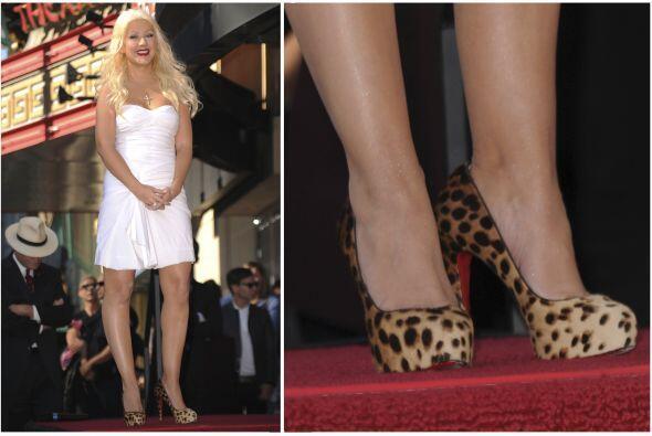 Igualmente, Christina Aguilera eligió el 'animal print' con vesti...