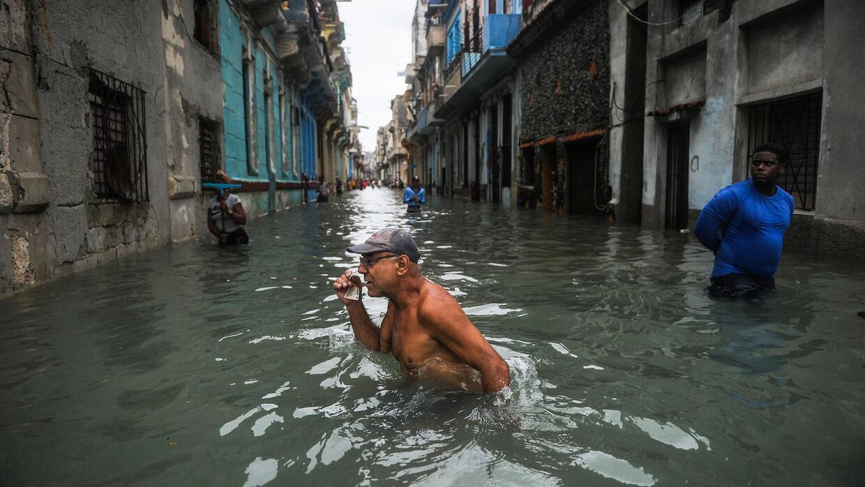 A Cuban wades through a flooded street in Havana on Sept. 10, 2017.