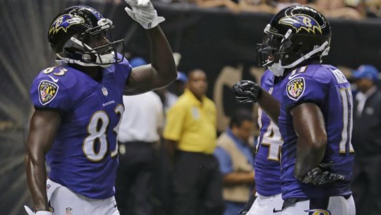 El receptorDeonte Thompson celebra su touchdown en la victoria de Raven...