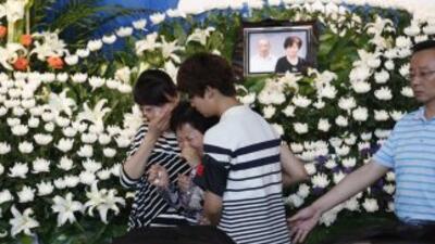 Miles de allegados de fallecidos en el accidente desplazados a Jianli ya...