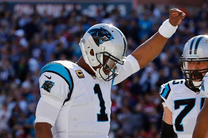 Newton completó 22 de 29 intentos para 316 yardas y una intercepción, ap...