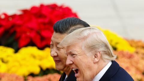 Donald Trump en uno de los encuentros que mantuvo con el presidente de C...