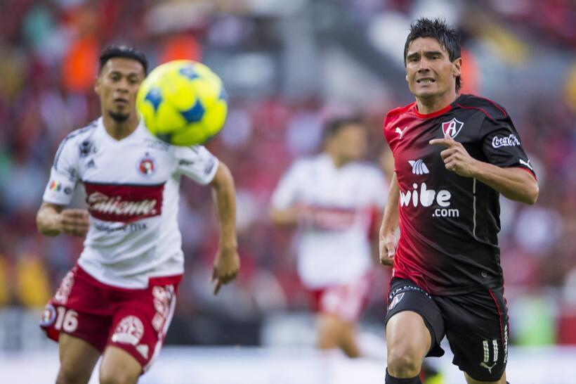 Con chilena de Avilés Hurtado, Xolos sacó el empate ante Atlas Matias Al...