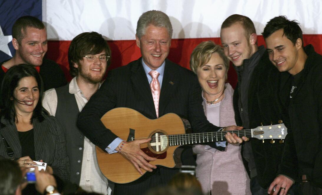 Former U.S. President Bill Clinton (4th R) and Senator Hillary Rodham Cl...