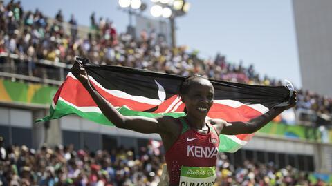 Jemima Jelagat Sumgong, of Kenya, celebrates after winning the gold meda...