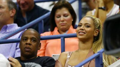 Beyoncé y Jay Z roban cámara en el abierto de tenis
