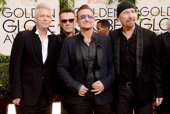 Adam Clayton, Larry Mullen Jr. y Bono no dejaron de posar para todas las...