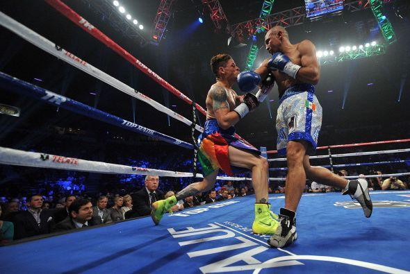 Buena pelea ofrecieron Orlando Cruz, quien intentó imponer su velocidad,...