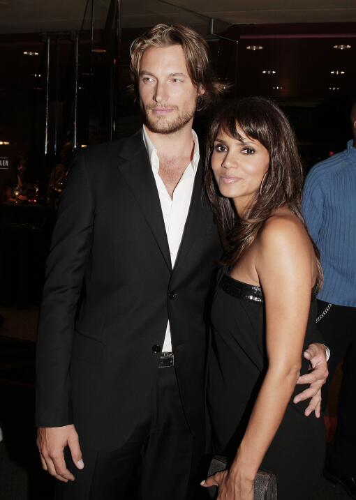 Actress Halle Berry (R) and model Gabriel Aubry pose at the afterparty f...