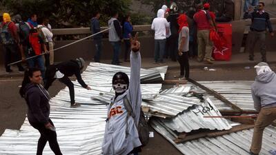En fotos: Enfrentamientos policiales con la oposición avivan crisis por el resultado de las presidenciales en Honduras