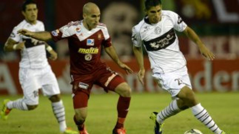Lanús, con su victoria del jueves por 0-2 contra el Caracas en Venezuela...