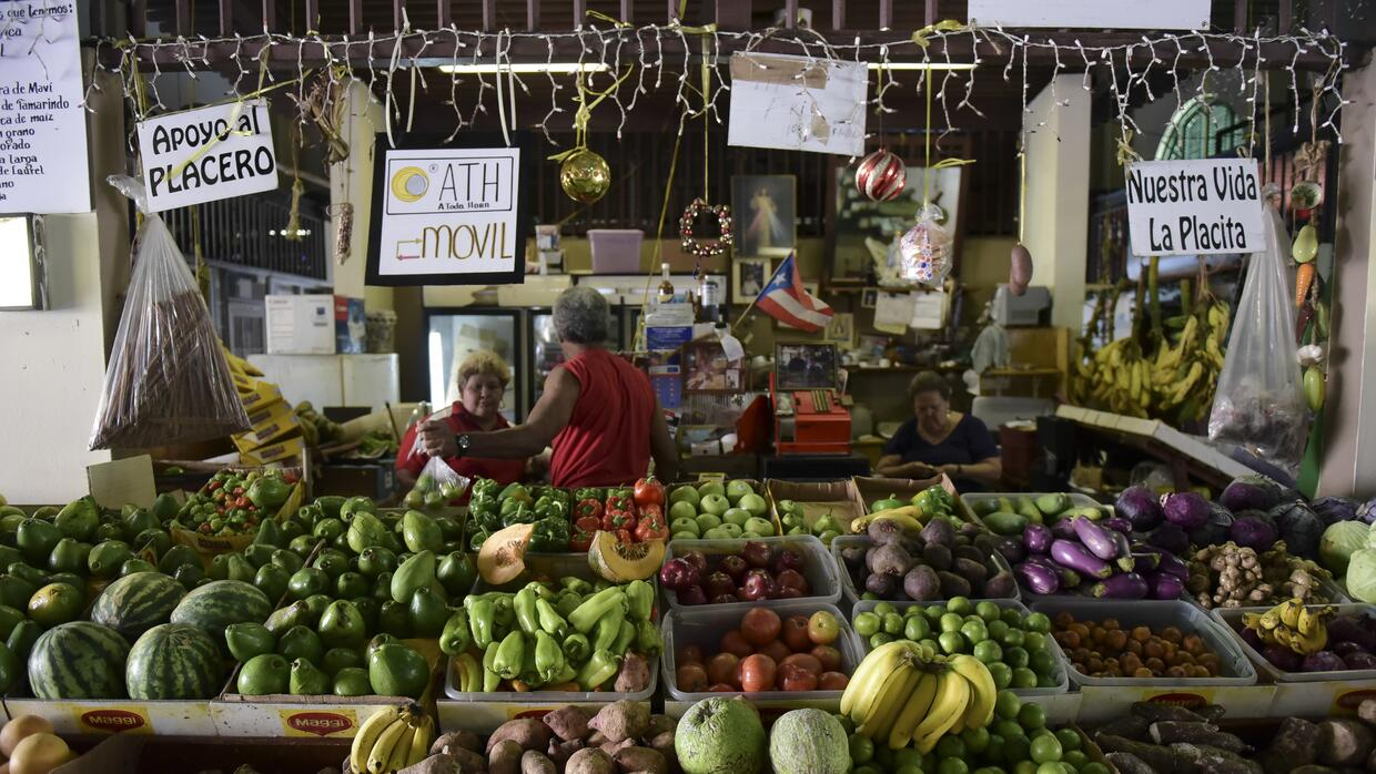 A produce stand at La Placita de Santurce farmers' market sells most...