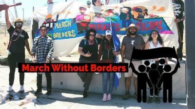 Activistas marchan de Los Ángeles a Tijuana, México, para recibir a la c...