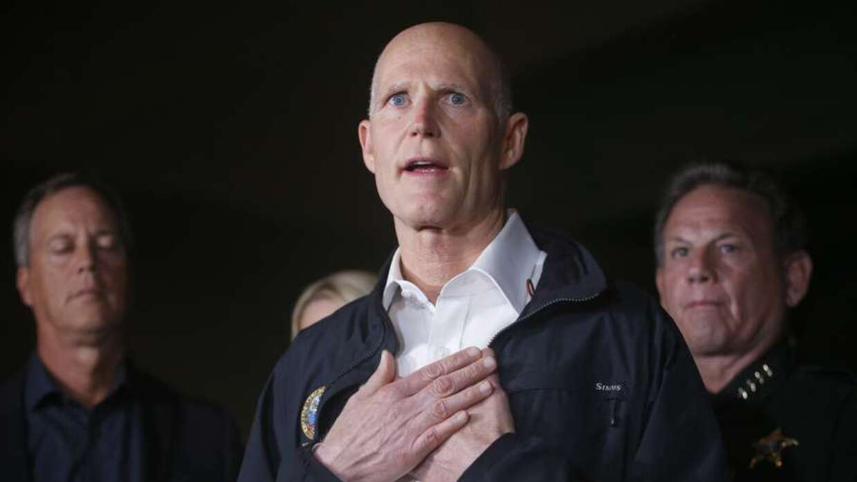 Florida Gov. Rick Scott gestures as he speaks during a news conference n...
