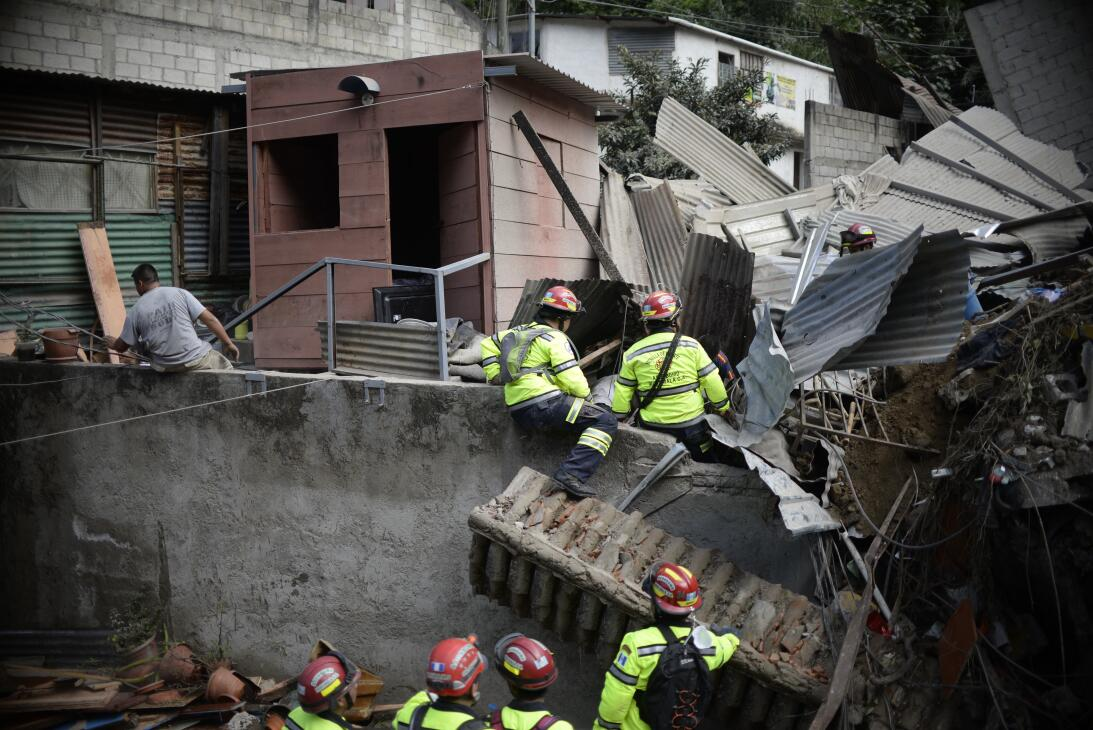 Rescuers search for victims after a landslide at Cambray village, in San...