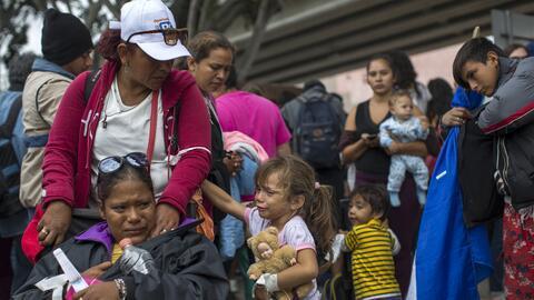 En la imagen, algunas de las 200 personas que llegaron en la caravana de...