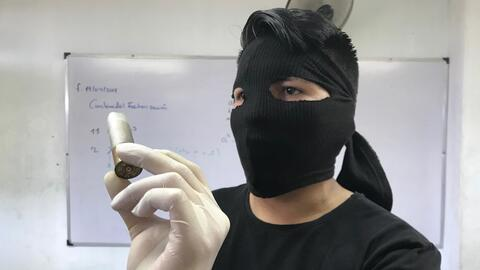 A masked Upoli student show bullet cartridge from police attack on the c...