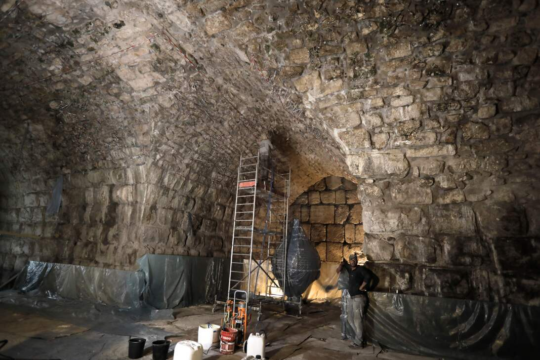 Workers restore a ceiling of the Western Wall tunnels near the site wher...