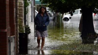 Un temporal de lluvias que azota Argentina obligó a miles de argentinos...