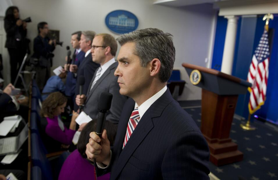 Network and cable news correspondents including CNN's Jim Acosta (C)...