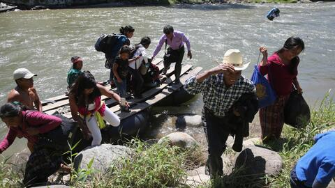 Migrants cross the Suchiate River that divides Mexico and Guatemala.
