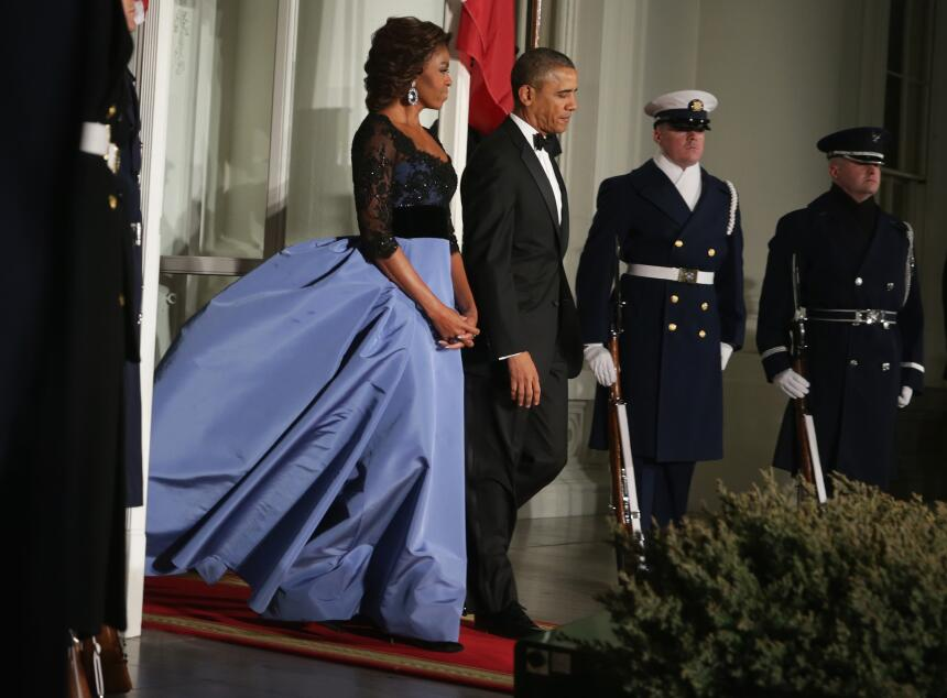 At the 2014 state dinner for France wearing Carolina Herrera.