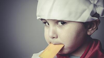 toddler with chef hat and spatula