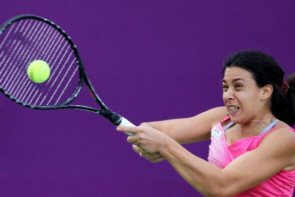 Marion Bartoli, de Francia, le pone mucha pasión al juego. Su rostro lo...