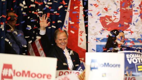 Doug Jones celebrates victory.