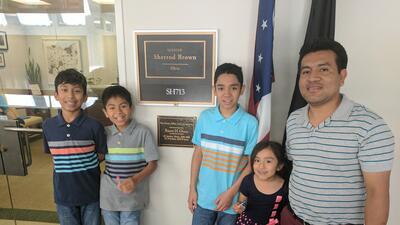 Jesús López Lara with his four U.S.-born children in front of Sen. Sherr...