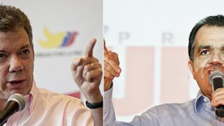 El presidente de Colombia, Juan Manuel Santos, y el candidato uribista,...