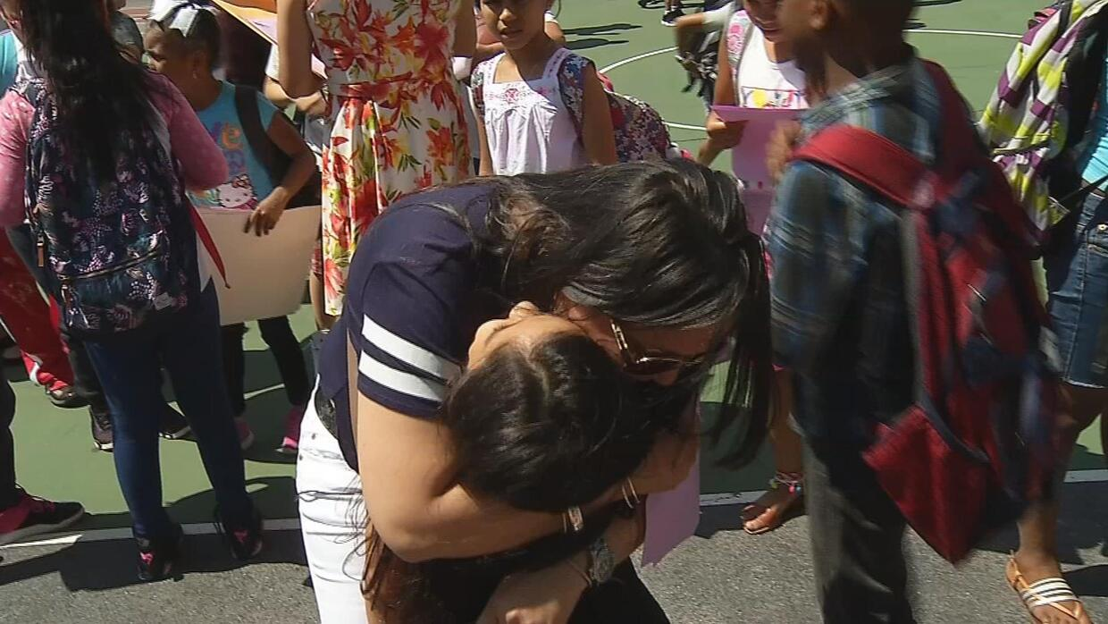 Arlette and her mother Clotilde hug during the last day of class.