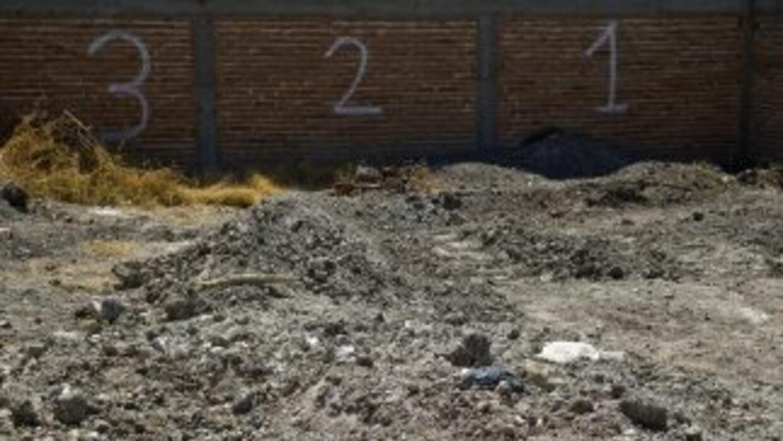 El total de cuerpos encontrados en Durango y Tamaulipas, dentro de fosa...