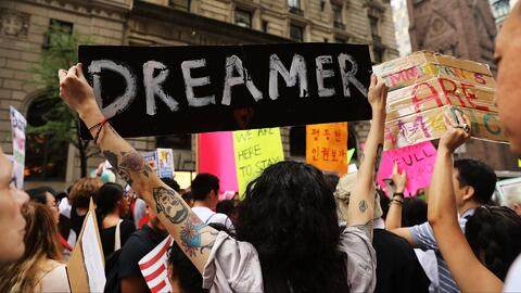 Dozens of immigration advocates and supporters attend a rally outside of...