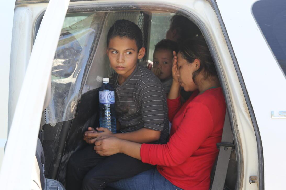 After about 15 minutes, a van arrives to take this group of 7 migrants t...