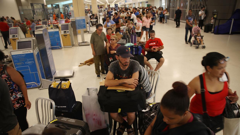 SAN JUAN, PUERTO RICO - SEPTEMBER 25: Edgar Algarin (C) and others wait...