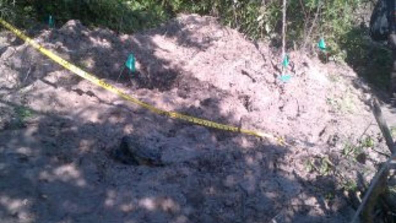 Hasta el 25 de octubre la PGR precisó que habían encontrado 11 fosas cla...