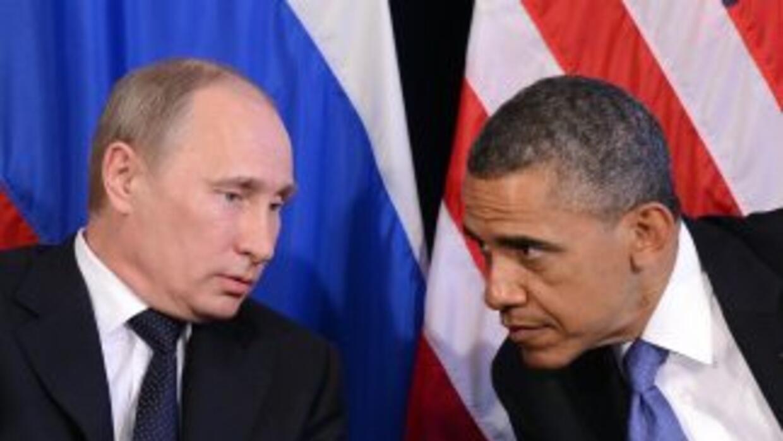 El presidente Vladimir Putin advirtió a Snowden que tenga cuidado en rea...